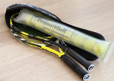 Tennis rackets and tennis ball pressure tube