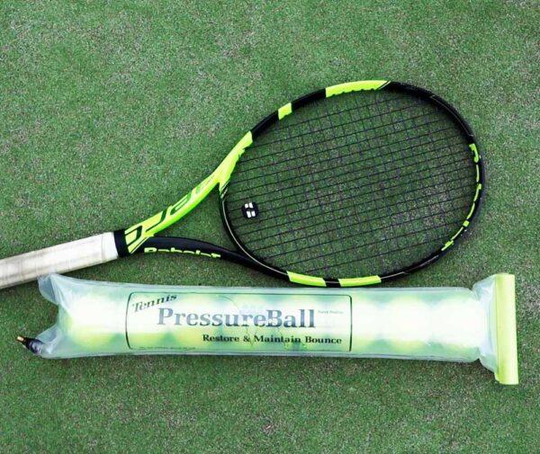 tennis racket and pressureball tube