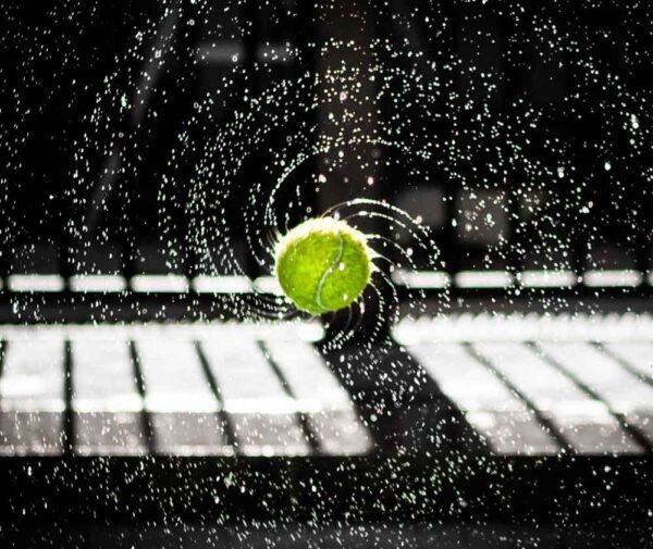 Tennis ball with water splash